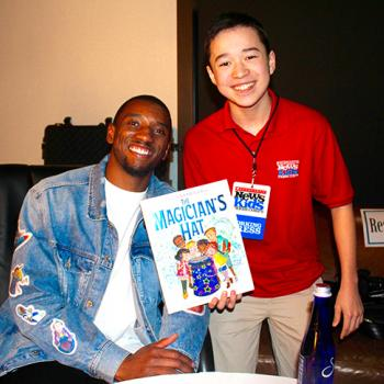 Maxwell with author and football star Malcolm Mitchell at An Unlikely Story Bookstore in Plainville, Massachusetts