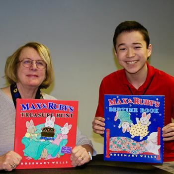 Max and Rosemary Wells holding Max and Ruby books at the Wellesley Free Library in Massachusetts