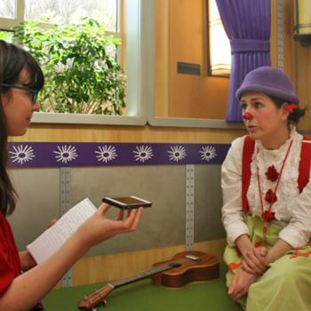 Esther Appelstein talks with Claire Wedemeyer from Clowns on Call before a performance.