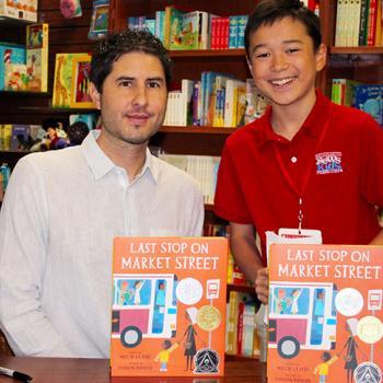 Max and children's author Matt de la Pena at Wellesley Books in Wellesley, Massachusetts