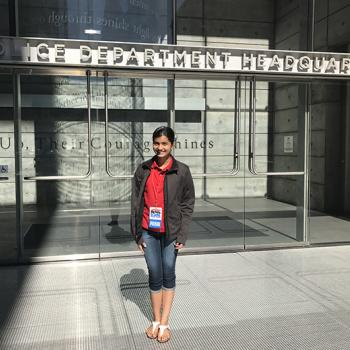 Manat Kaur standing outside the San Francisco Police Department headquarters.