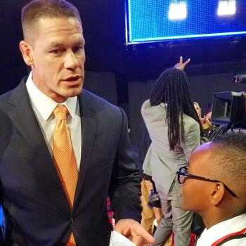 Owen interviewing John Cena on the red carpet