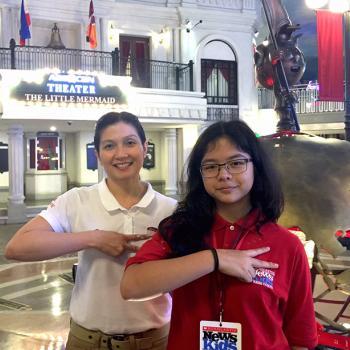 "Pinky Laurena, Minister of Visitor Experience at KidZania Manila, and Georgia gesture ""hello,"" or ""kai,"" the KidZania way."