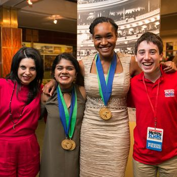 "Left to right: Meg Zucker, Ethan's mother; student winners Anushka Nair and Lindsay Pierce; and Ethan. Meg Zucker is Founder and President of Don't Hide It, Flaunt It, a nonprofit organization that works to advance understanding, tolerance, and mutual respect for people's differences. The RBC ""Flaunt It"" Award was created with funding from RBC Foundation—USA."