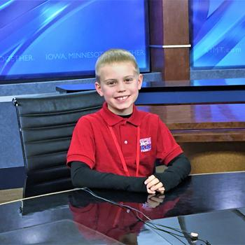 Brandon tries out the news anchor desk at KIMT