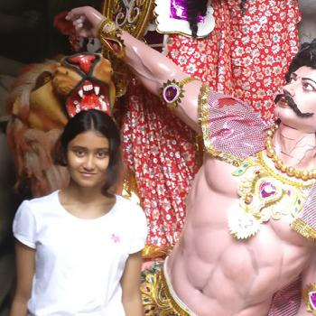 Scholastic Kid Reporter Roopkatha Roy in front of a  workshop at Kumartuli