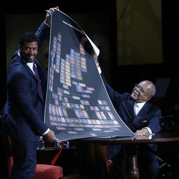 Gates presents Wilson with a paper copy of his complete family tree.