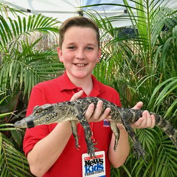 Ryan holding an alligator