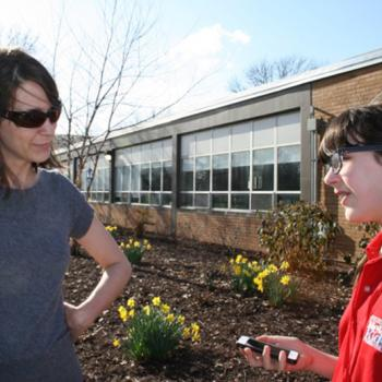Esther talks with voter Beth Veccaro.