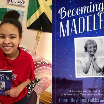 Adedayo with a copy of Becoming Madeleine