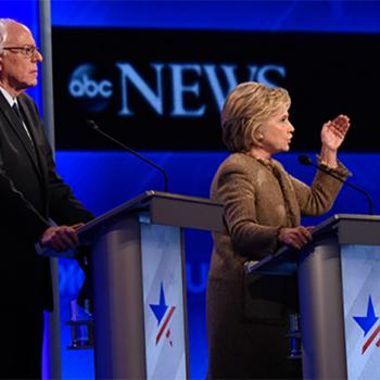 Left to right: Vermont Senator Bernie Sanders, and former Secretary of State Hillary Clinton debate the issues on December 19 in Manchester, New Hampshire.