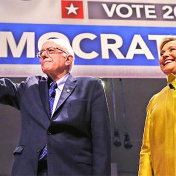 Vermont Senator Bernie Sanders and Former Secretary of State Hillary Clinton greet the crowd at the University of Wisconsin in Milwaukee. Sanders and Clinton are vying for the Democratic nomination for president.