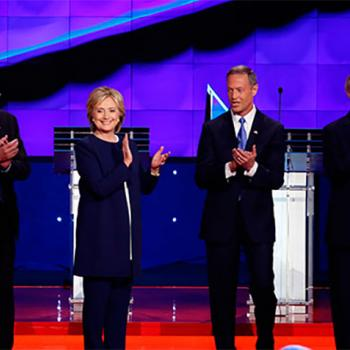 Democratic presidential candidates applaud after the national anthem at the party's first debate on October 13 in Las Vegas, Nevada. Left to right: Vermont Senator Bernie Sanders, former Secretary of State Hillary Clinton, former Maryland Governor Martin O'Malley, and former Rhode Island Governor Lincoln Chafee.