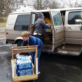 Benjamin helps deliver water to families in Flint, Michigan.
