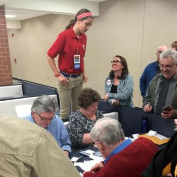 Lilian watches votes being counted at a Republican caucus at Urbandale High School in Iowa.