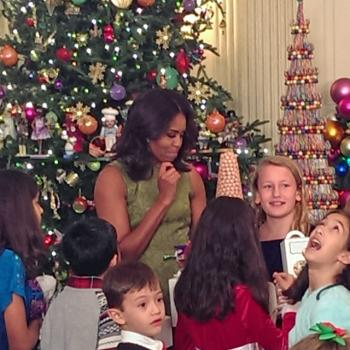 First Lady Michelle Obama visits with children of the armed forces at a holiday event at the White House.