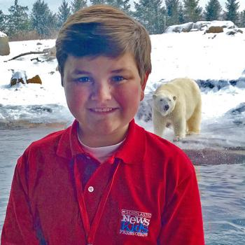 Nolan visits the Polar Frontier area of the Columbus Zoo and Aquarium.  In the background is Aurora, one of five polar bears at the zoo.  Aurora gave birth to twin cubs (Neva and Nuniq) at the zoo in November, 2016. The Columbus Zoo is the only zoo in North America to have polar bear cubs born in 2016.