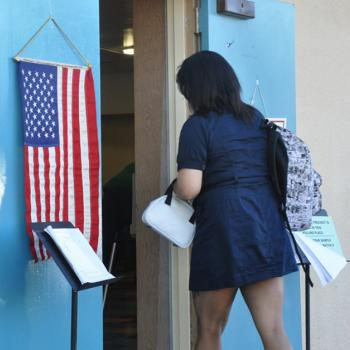 A young voter, Ipod in hand, goes to the polls in Los Angeles.
