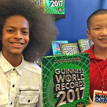 Kid Reporter Joshua Yi (right) with Tyler Wright, world-record holder for largest male afro