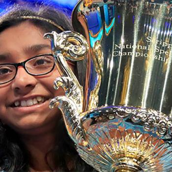 "Ananya Vinay, a sixth-grader from Fresno, California, hoists the Scripps National Spelling Bee trophy after her win. Vinay's favorite word is spizzerinctum, which means ""the will to succeed."""