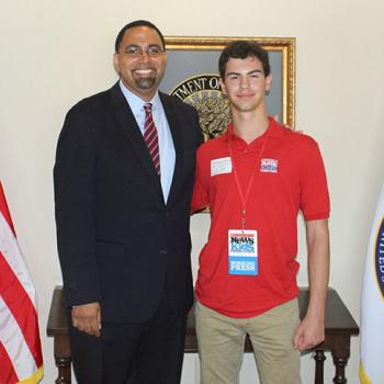 Erik with US Secretary of Education, Dr. John King