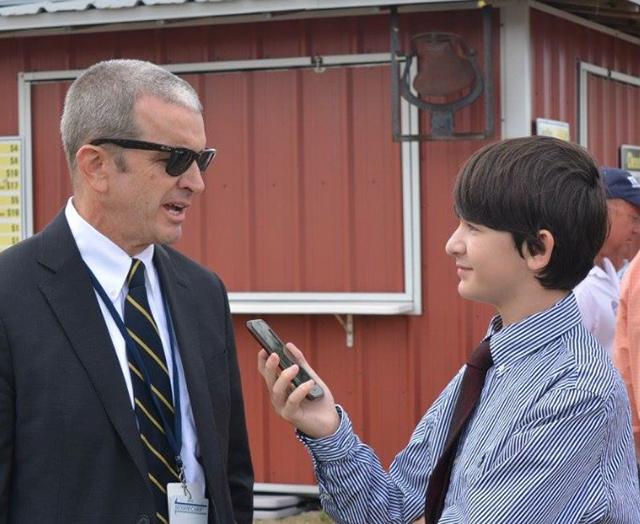 Benjamin interviewing George Bennett of the Palm Beach Post