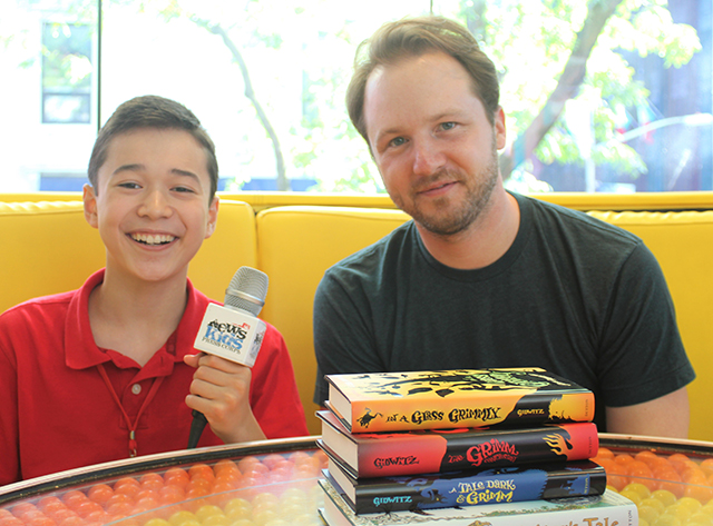 Maxwell with author Adam Gidwitz at Dylan's Candy Bar in New York City